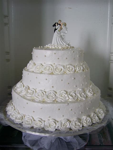white wedding cake with roses of whipped cream   Takes The