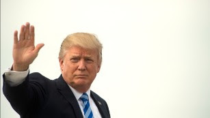 As advisers cross globe to hotspots, Trump stays put
