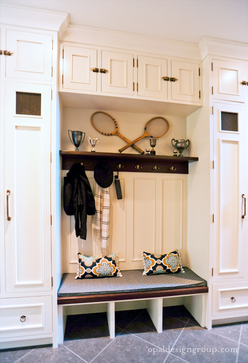 Mud room with floor to ceiling white cabinets lockers and built-in bench