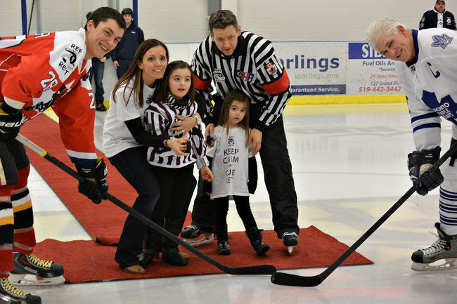 Ian Fowler of the Paris Mounties alumni, Lory Morton and her daughters Elle Morton and Paige Morton, and former Maple Leaf captain Rick Vaive pose for a ceremonial puck drop at the Ref4Rett event last weekend in Paris.(Submitted Photo)