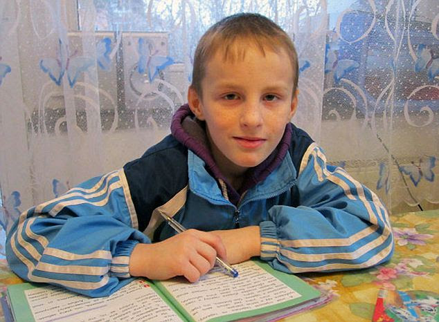 Artem Saveliev, aged nine, is now living with a foster family outside Moscow. Last spring his American adoptive mother put Artem, who was then going by the American name Justin, alone on a plane to Russia with a note pinned to his clothing