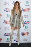 Jennifer Lopez Minivestido Con Botas Mosqueteras
