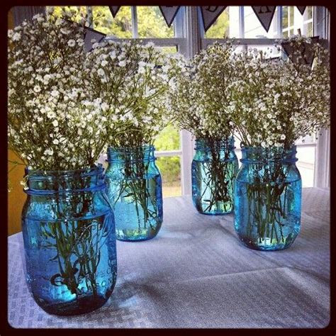 Blue mason jars and baby's breath as center pieces at my