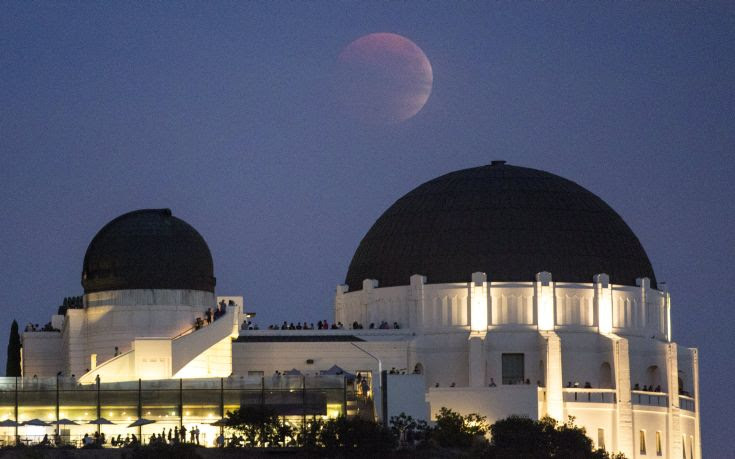 A supermoon is seen in the sky above Griffith Park Observatory in Los Angeles, California