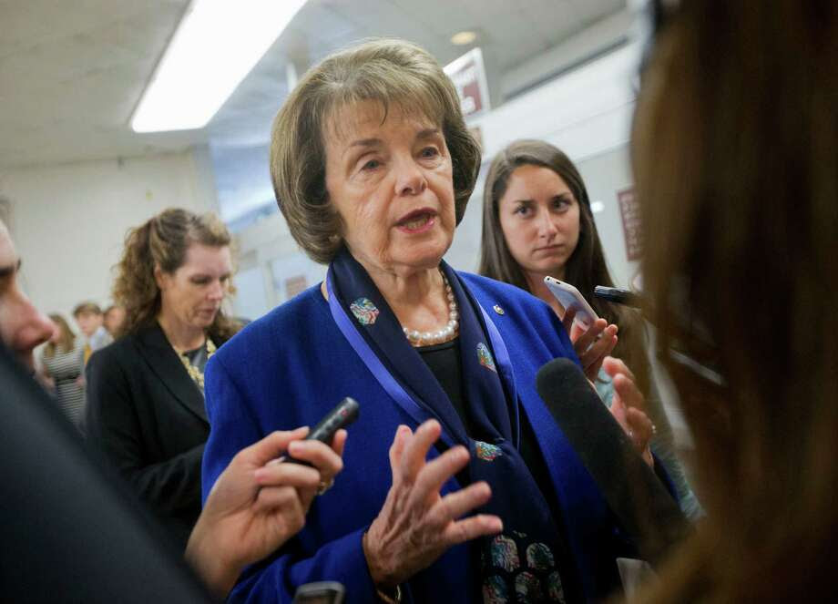 Sen. Dianne Feinstein, D-Calif. speaks with reporters on Capitol Hill in Washington in June. The senator has called for an end to the controversial EB-5 regional center program that lets foreign nationals pay for green cards for themselves and their families. Photo: Pablo Martinez Monsivais / Pablo Martinez Monsivais / Associated Press / AP