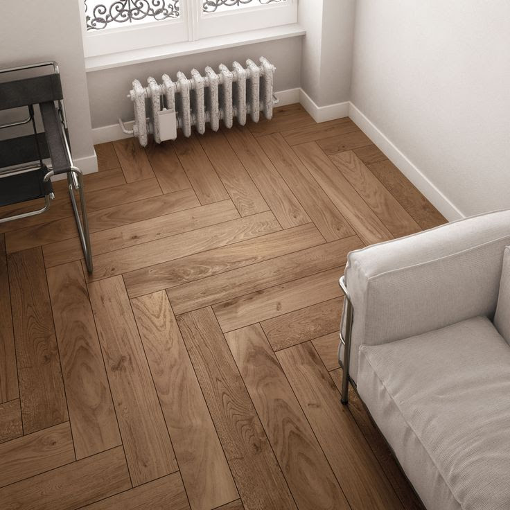 The herringbone pattern achieves a contemporary effect with wood look ceramic tile