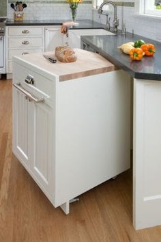 Rolling cabinets and mobile islands make quick work of kitchen prep. It sounds so simple, but so few of us think of it: make one base cabinet a rolling element, with a built-in chopping-block top for at-your-service accessibility. If you don't like the look of casters, have your cabinetmaker conceal the wheels with a plinth for a completely inconspicuous solution. It's also great for bringing dishes back and forth from the table to the sink if you have trouble carrying a lot of items at once.
