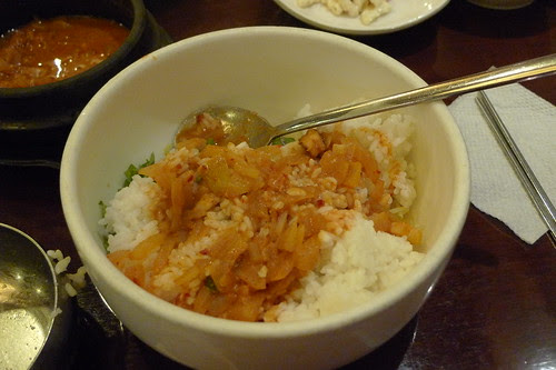 Mixing spicy soy bean soup into rice
