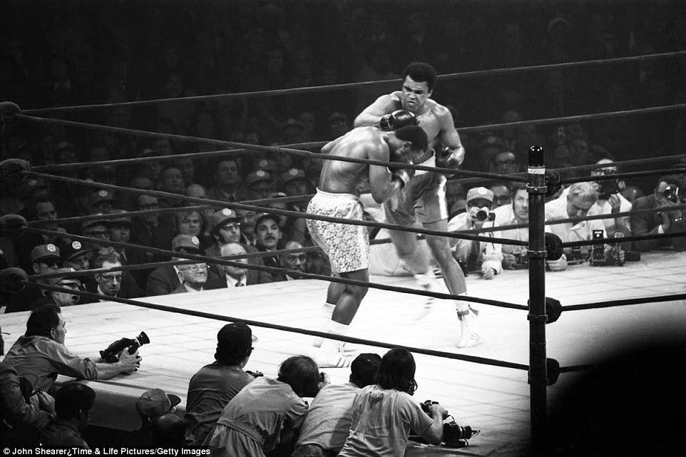 Ali and Joe Frazier battling it out in 1971 at Madison Square Garden in what became known as the 'Fight of the Century'