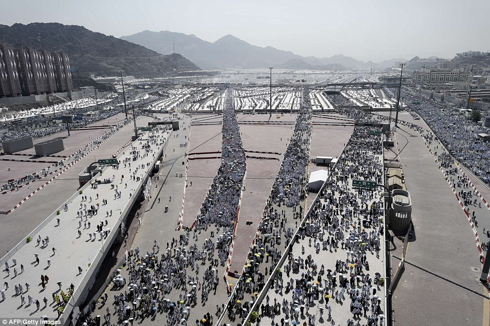 Muslim pilgrims arrive to throw pebbles at pillars during the Jamarat ritual, representing the stoning of Satan, in Mina, near the holy city of Mecca