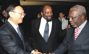 Mines and Mining Development Minister Obert Mpofu exchange MoU documents with Chinese Deputy Minister of Commerce Mr Li Jinzao, while Vice President Joice Mujuru looks on in Harare on May 22, 2013. by Pan-African News Wire File Photos