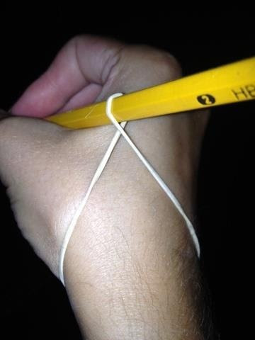 Teaching proper way to hold a pencil. Use elastic or string.