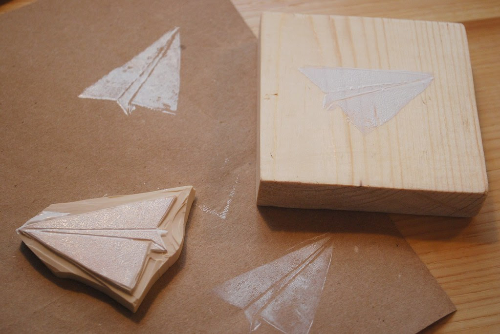 paper airplane on wood and kraft