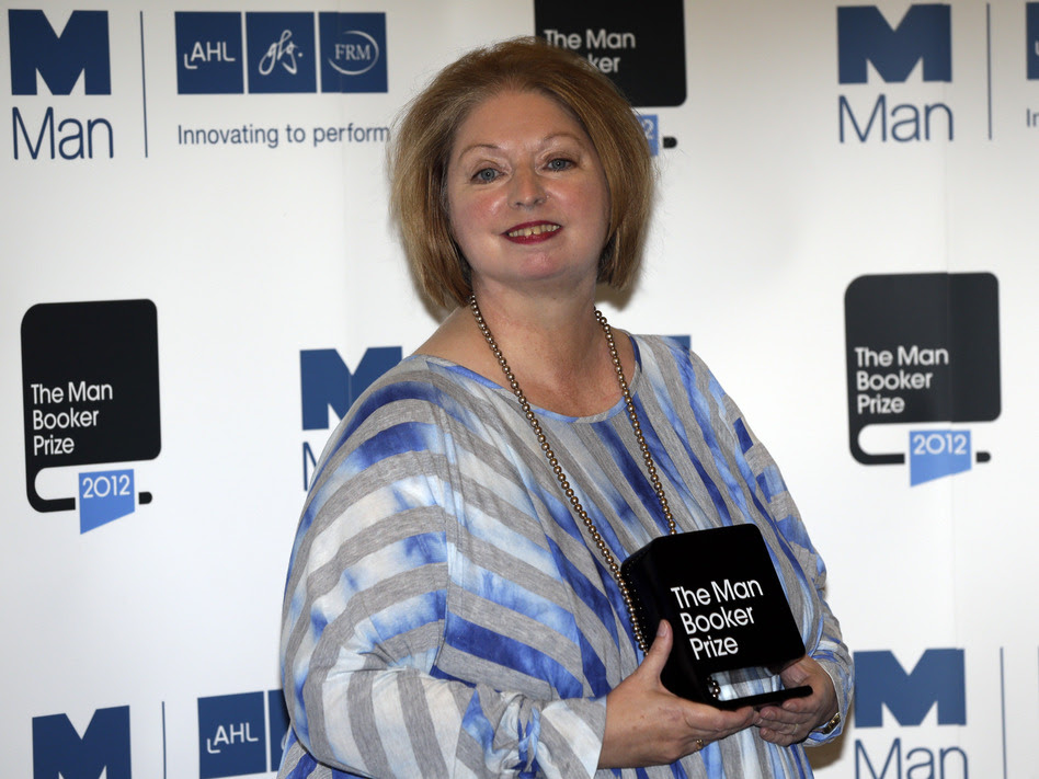 Hilary Mantel, winner of the Man Booker Prize for Fiction, poses with her prize shortly after the award ceremony in London Tuesday. Mantel, won the 50,000 British pounds (approximately $80,000) prize with her book Bring up the Bodies.