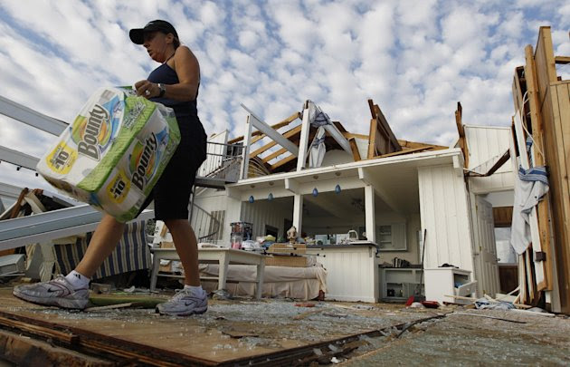 Denise Robinson clears out her destroyed beach home in the Sandbridge area of Virginia Beach after Hurricane Irene hit Virginia Beach, Va., Sunday, Aug. 28, 2011.  Officials speculate that a tornado s