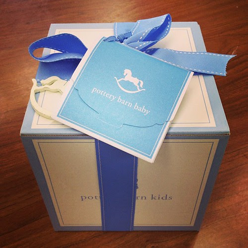 My very first gift wrapped with a BLUE ribbon!! It's becoming more & more real that I'm having a Baby Boy!! #babyboy #blueribbon #potterybarnbaby