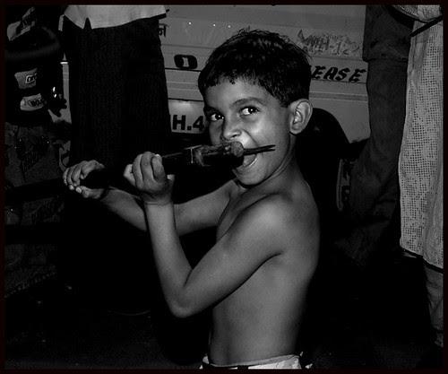 Sharukh Rafaee - Cutting Tongue With An Axe by firoze shakir photographerno1