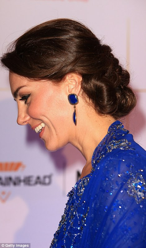 Kate's blue bold drop earrings, pictured, from luxury Indian jewellers Amrapali, were also the topic of much conversation
