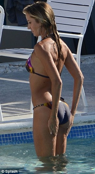 Brining up the rear: Lauren showed off her pert derrière after a dip in the water