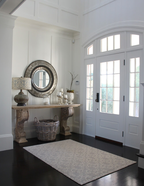 Great entry with lots of light. Love the table with giant corbels! | Friday Favorites at www.andersonandgrant.com