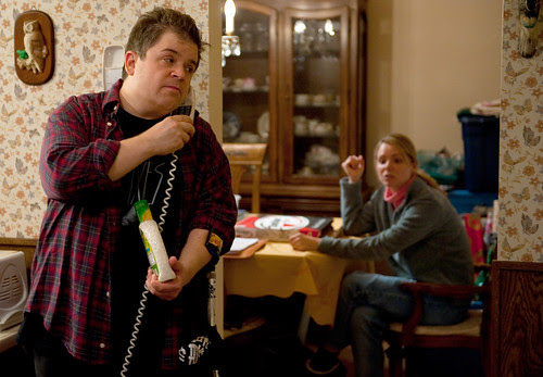 Left to right: Patton Oswalt plays Matt Freehauf and Collette Wolfe plays Sandra Freehauf in YOUNG ADULT, from Paramount Pictures and Mandate Pictures