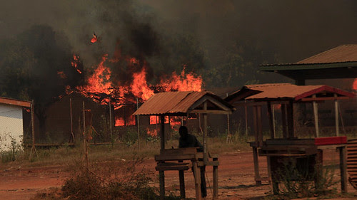 Home fires raging in the city of Bossangoa north of the capital Bangui in the Central African Republic. French intervention has worsened the dislocation and conflict. by Pan-African News Wire File Photos