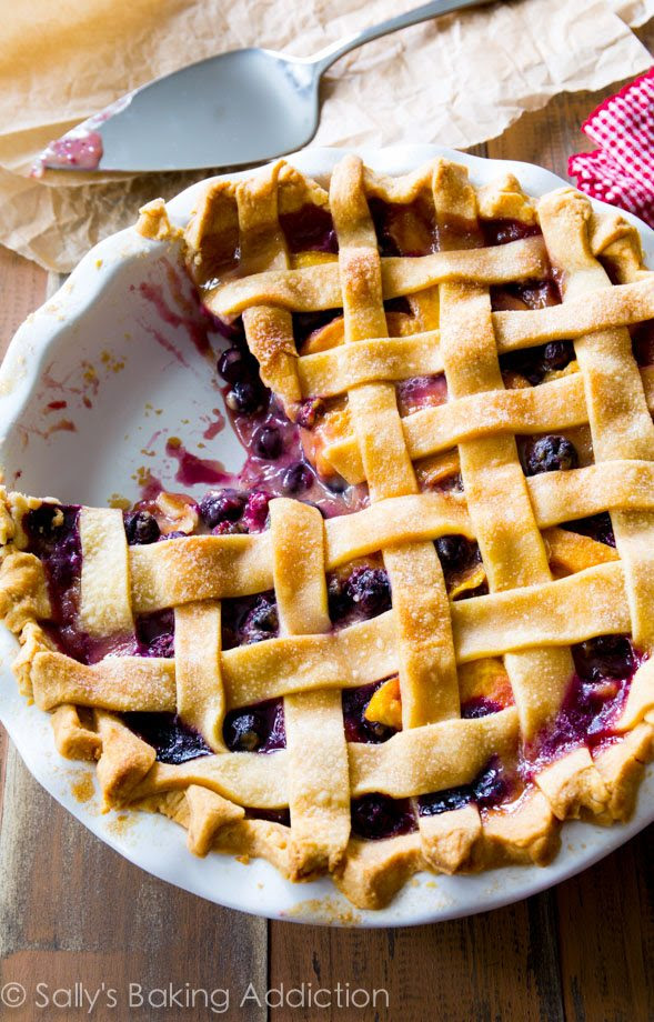 A classic lattice-topped homemade blueberry peach pie bursting with juicy flavor. You will love this pie crust too! @sallybakeblog