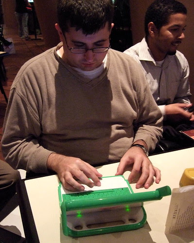 Ross Karchner plays with the OLPC X0-1