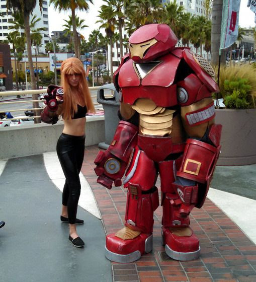 Cosplayers dressed as Pepper Potts from IRON MAN 3 and the Hulkbuster from AVENGERS: AGE OF ULTRON strike a pose at Long Beach Comic Con...on September 12, 2015.