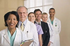 Photo of a group of health care professionals, men and women, working together.