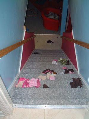 clothes thrown down stairs