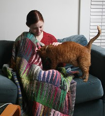 Mom, cat and blanket