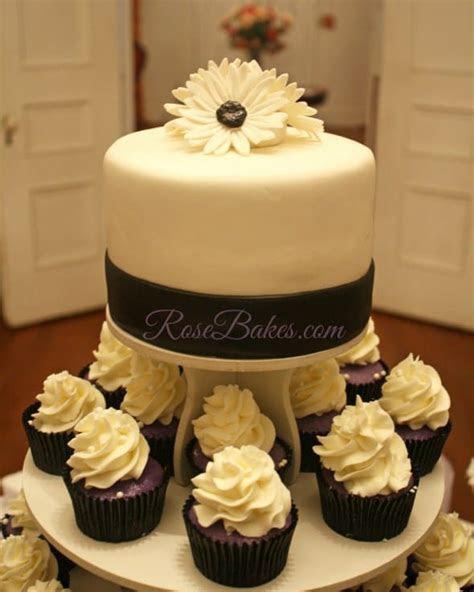 Black, White, & Purple Wedding Cake and Cupcake Tower