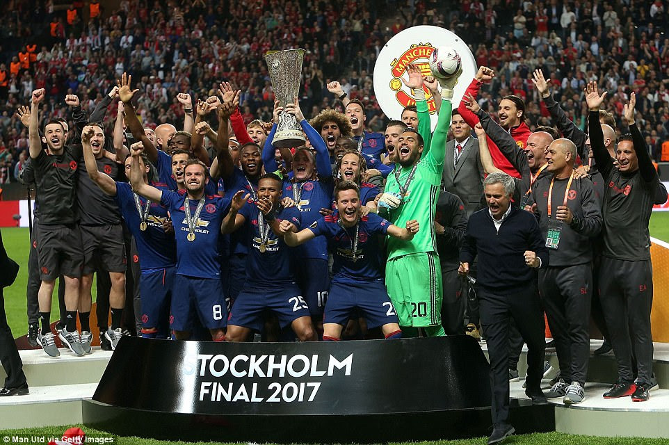 It's party time at the Friends Arena in Stockholm as Rooney and his team-mates celebrate with their trophy on the pitch