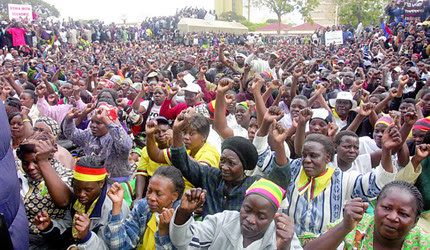 Members and supporter of the Zimbabwe African National Union Patriotic Front Party outside headquarters in Harare. The party is preparing for harmonized elections in July 2013. by Pan-African News Wire File Photos