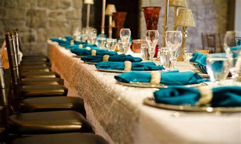 Blue and white wedding table settings, gold and turquoise
