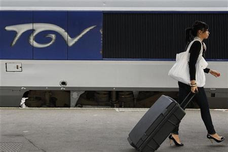 A commuter walks on a TGV train platform at Nantes's railway station in this September 7, 2010 file photo. REUTERS/Stephane Mahe/Files