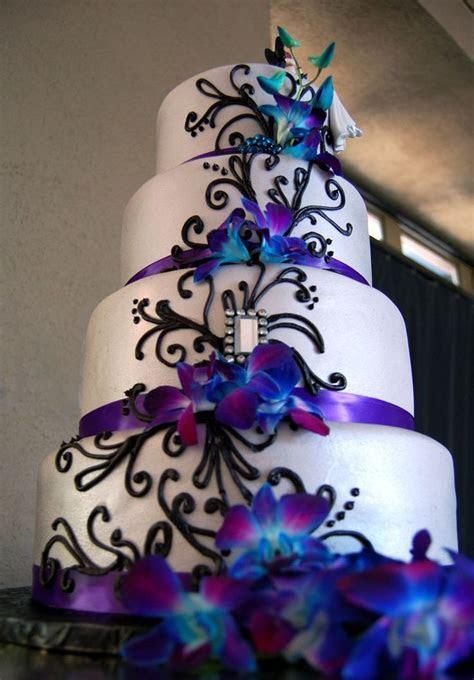 Fondant wedding cake with purple satin ribbon, black