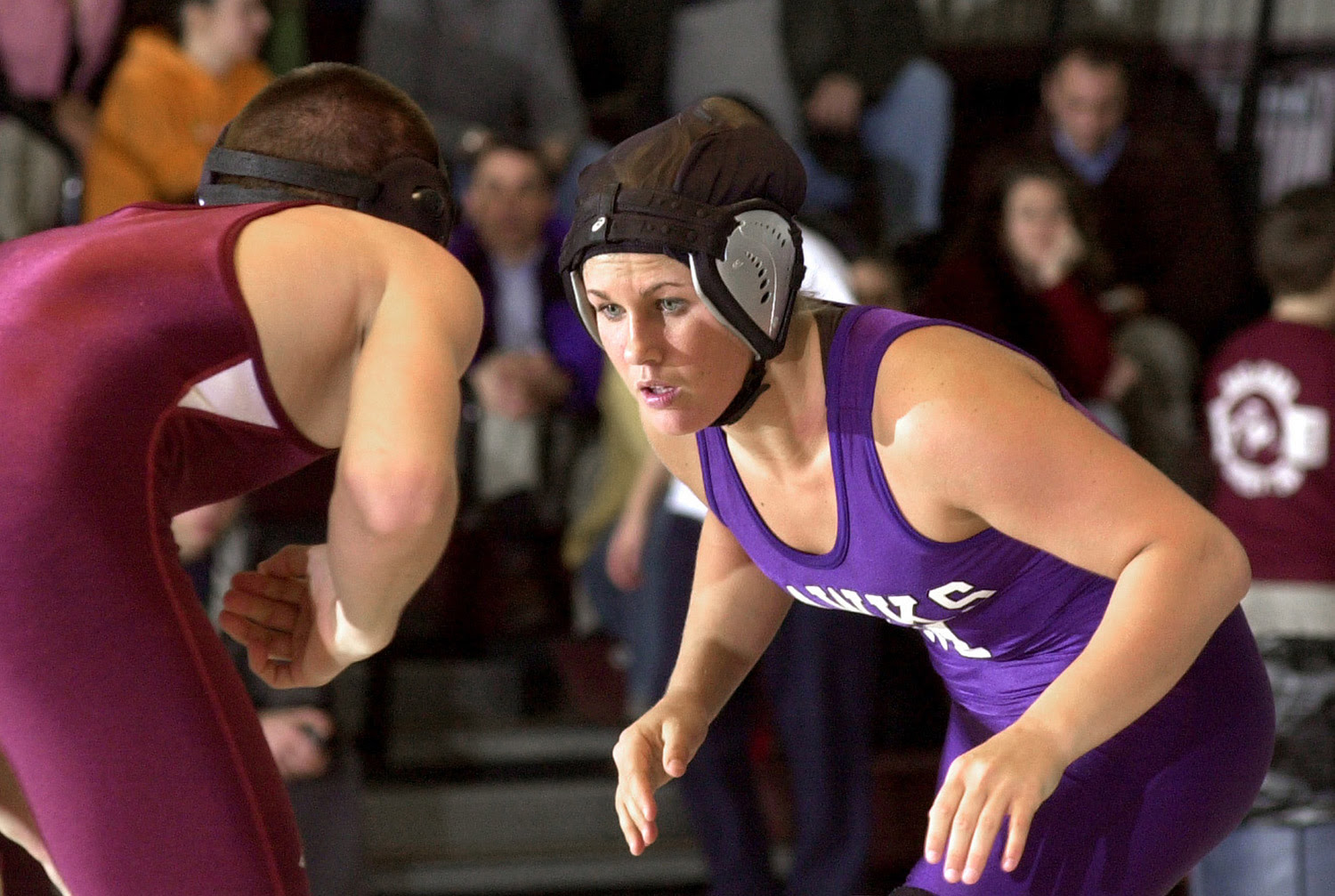Deanna Rix, wrestling for Marshwood High in January 2005, takes on Noble's Heath Devoll in the 130-pound class. She won the match.