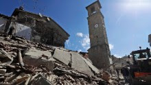 Rescuers search for survivors amidst the rubble following an earthquake, in Amatrice, Italy August 24.