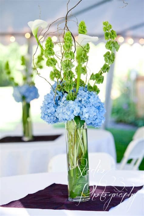 blue and green wedding flowers table decor centerpiece