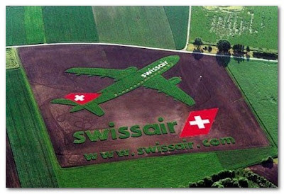 swiss air ad in a field