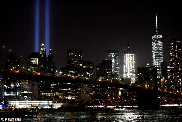 On the eve of 9/11 thousands of New Yorkers prepare for the 15th anniversary of the terror attacks that saw nearly 3,000 people lose their lives. The Tribute in Light memorial could be seen in the Manhattan skyline from the Brooklyn Bridge Park (top left)