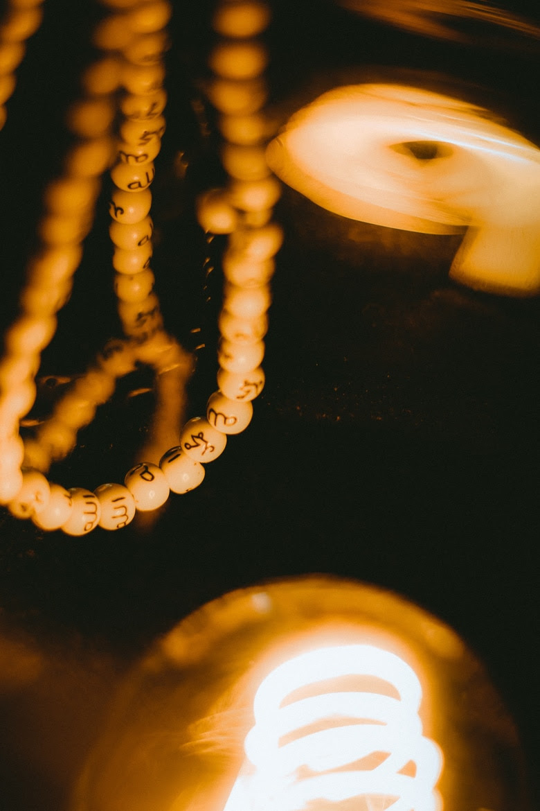 For Bell Let's Talk, prayer beads next to a lamp