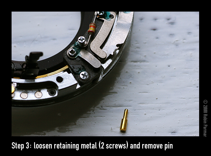 Step 3: loosen retaining metal (2 screws) and remove pin