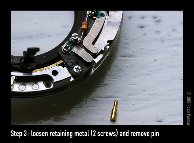 Step 3: loosen retaining metal (2 screws) and remove pin