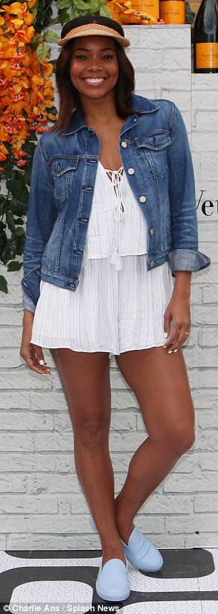 White hot! Union wore a bohemian chic white playsuit and a pair of cosy baby blue trainers