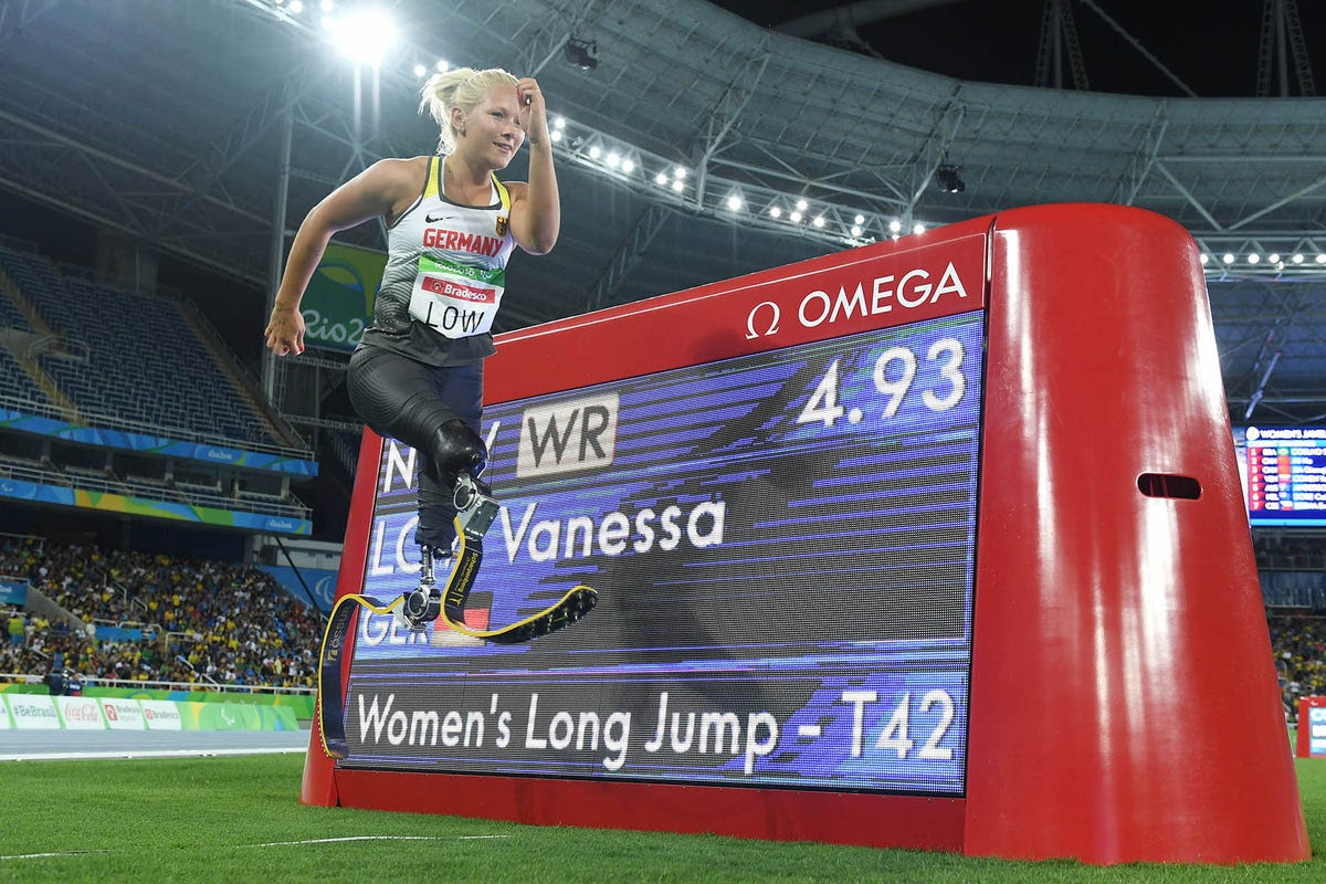 Vanessa Low of Germany poses in front of the scoreboard announcing her world record in the women's long jump.