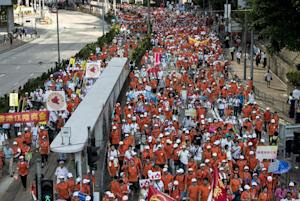 People take part in a pro-government rally in Hong…