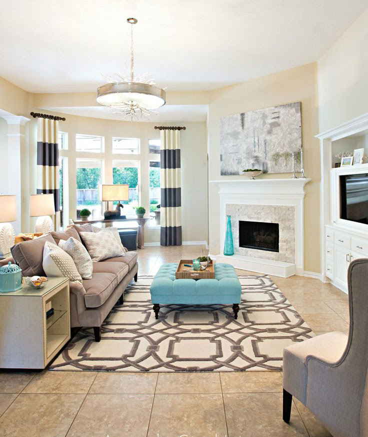 cream colored living room with pops of teal mygirlyroom
